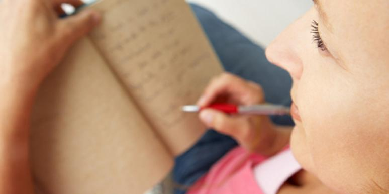 woman making a list in a notebook