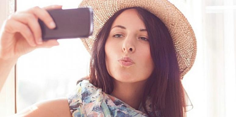 woman taking selfie in hat and scarf