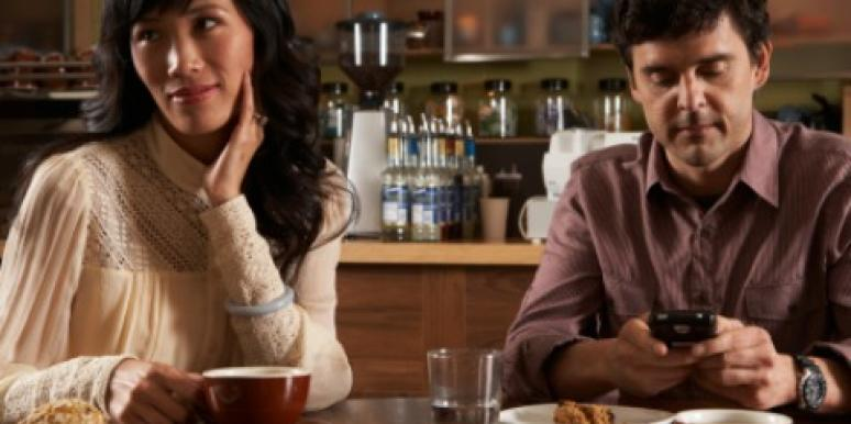 woman annoyed man phone dinner
