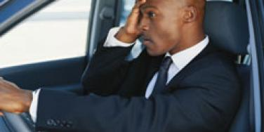 man stressed in the car