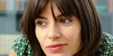 woman with brown hair, bangs, bob