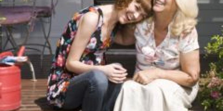 Mother and daughter sitting on a porch