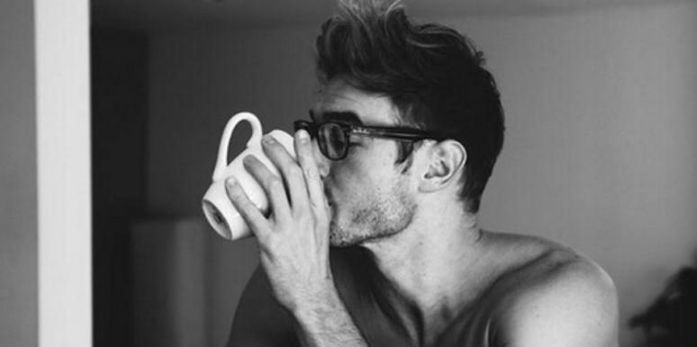 Sexy shirtless guy drinking cofee