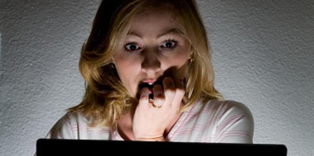 woman covering her mouth