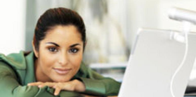 business woman in green shirt with laptop
