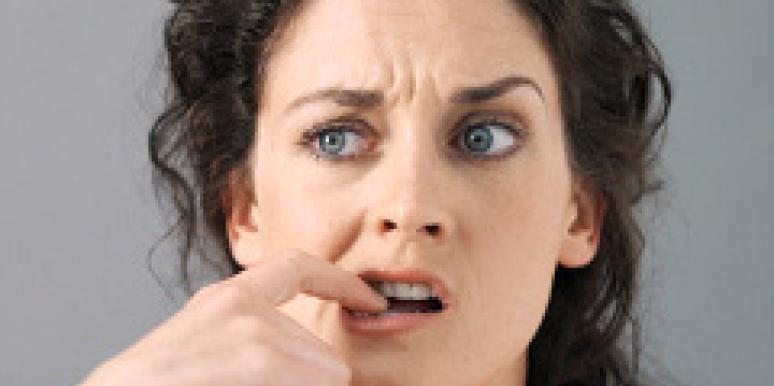 woman finger in mouth anxious pms