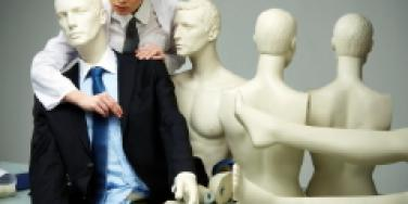 Woman dressing a mannequin