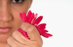 woman crushing flower in fist
