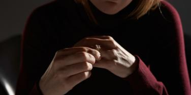 woman looking at wedding ring