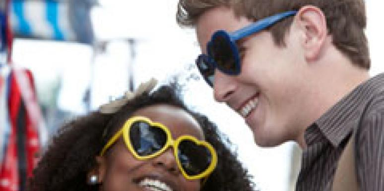 man and woman wearing heart sunglasses
