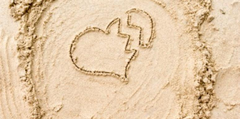 broken heart drawn in sand
