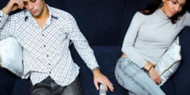 unhappy couple on couch