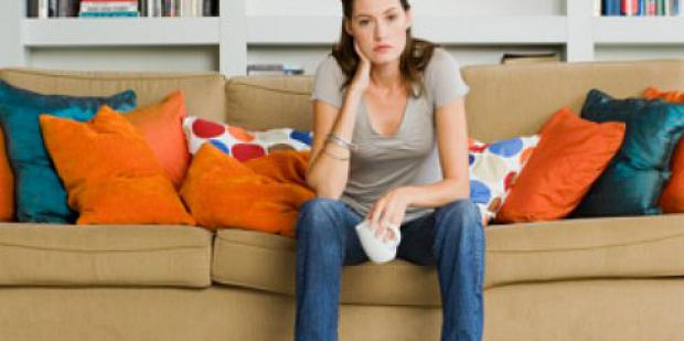 woman sad on the couch