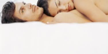 woman sleeping on top of man