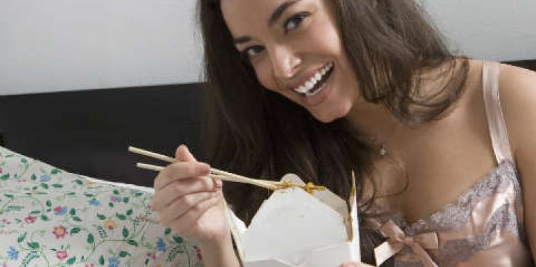 woman eating chinese food
