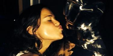 Michelle Rodriguez kissing a camera