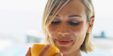 woman eating an orange