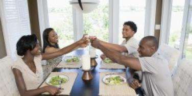 Two couples toasting