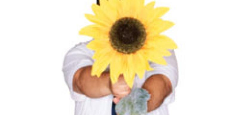 man holding giant sunflower