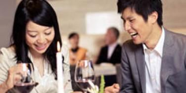 asian couple laughing on date