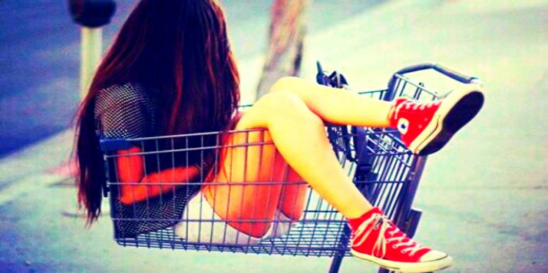 girl sitting in cart