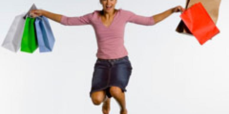 woman jumping with shopping bags