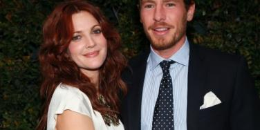 Drew Barrymore and Will Kopleman hug