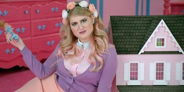 "Meghan Trainor playing with a dollhouse in her ""All About That Bass"" music video"
