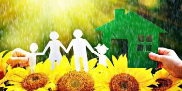 paper family in a sunshower