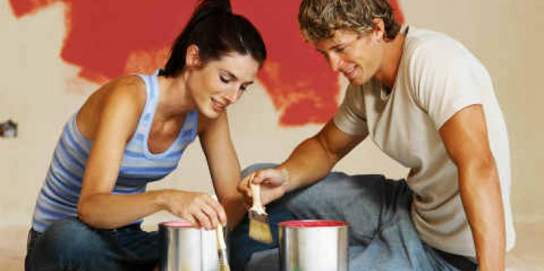 couple painting room red