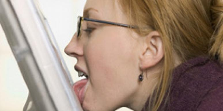 woman licking computer