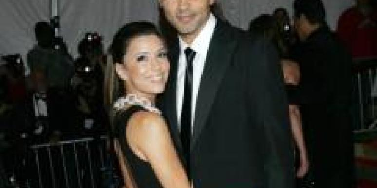 Eva Longoria and Tony Parker hugging.
