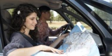 Couple in the car looking at a map