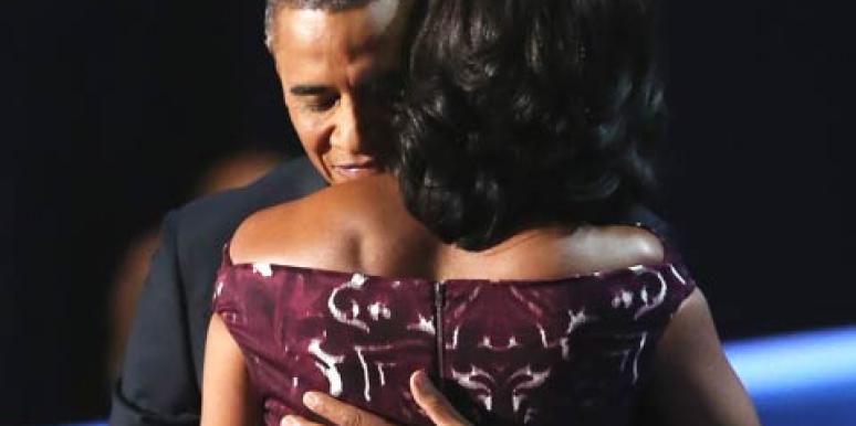 barack and michelle obama hug at dnc