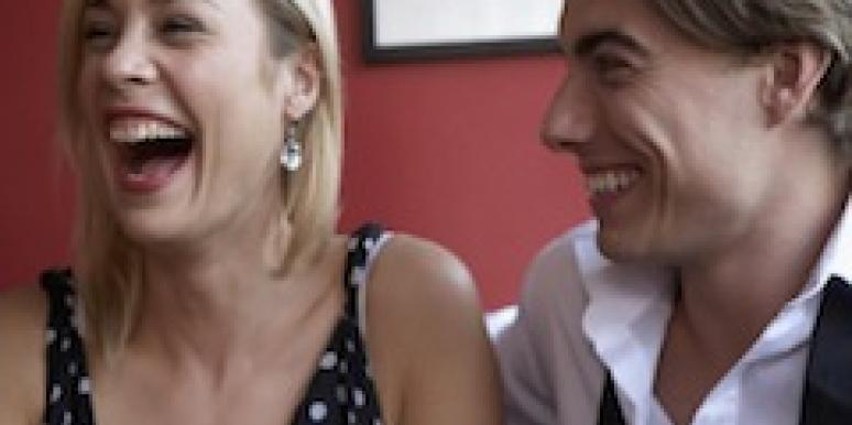 man and woman on date laughing