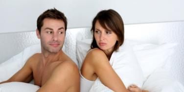couple upset in bed.