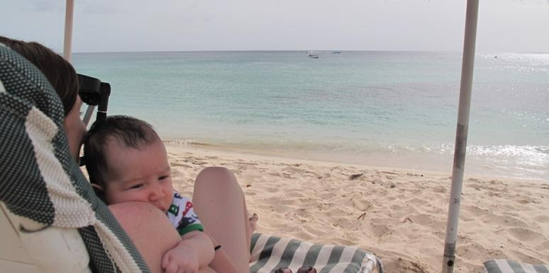 Author with baby on beach