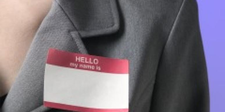 Name badge on a woman's suit jacket