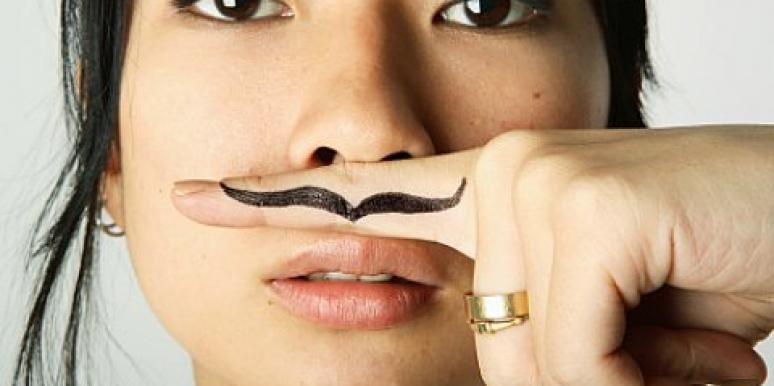woman with finger mustache