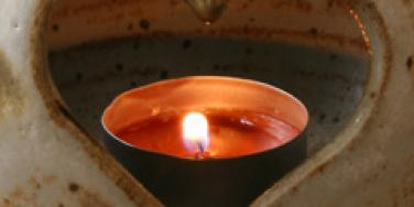 candle flame within a heart vessel