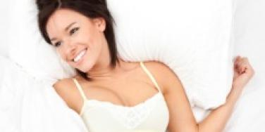 pleased woman in bed