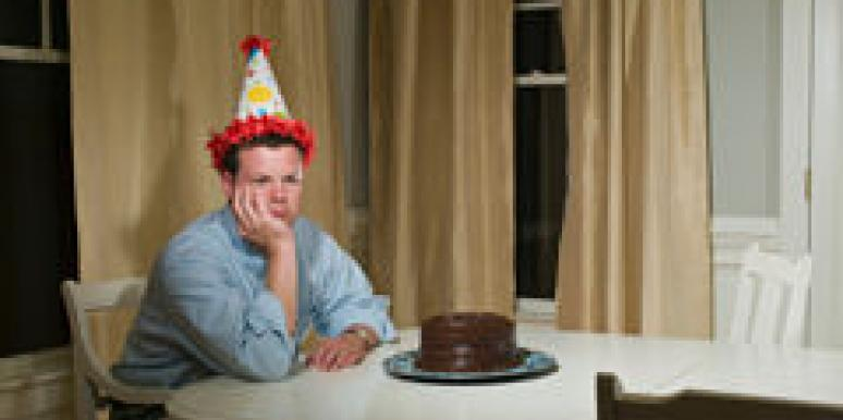 man alone with cake