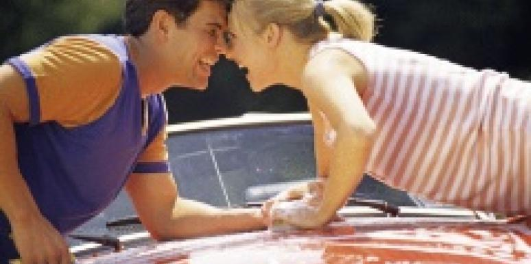 couple washing car and flirting