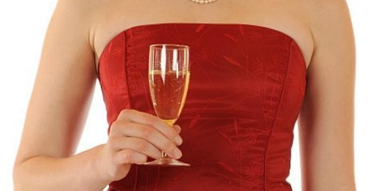 woman holding champagne