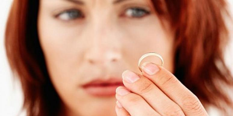 red hair woman looking at ring