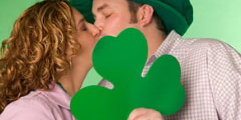 Couple kissing on St. Patrick's Day