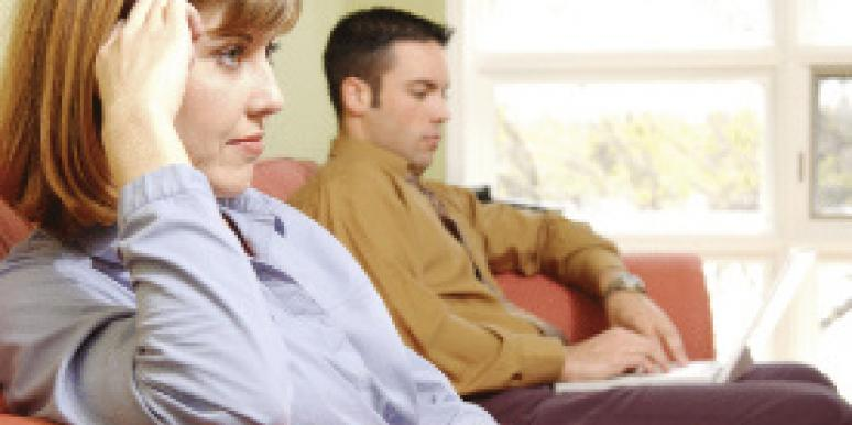 couple sitting separately on couch