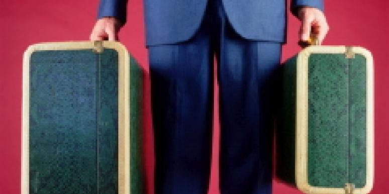 man with suitcases taking vacation from monogamy