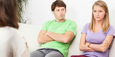unhappy couple with a therapist
