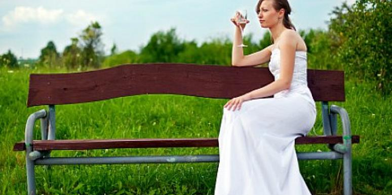 lonely woman in wedding dress